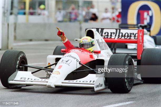 Brazilian F1 driver and current world champion Ayrton Senna waves to the crowd on March 10, 1991 after winning the 1991 edition of the US Grand Prix...