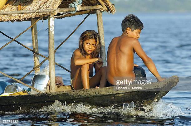 Brazilian family on the Rio Negro River on December 5 2004 in Manaus Brazil
