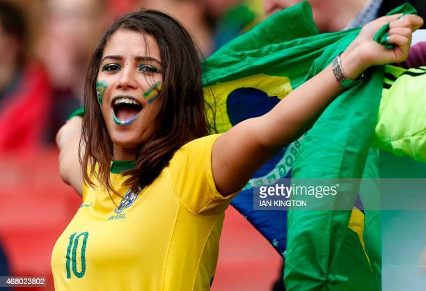 A Brazilian fan awaits kick off in the friendly international football match between Brazil and Chile at The Emirates Stadium in London on March 29...