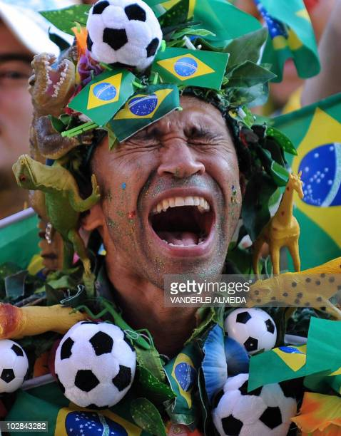 A Brazilian fan celebrates the first goal of the team as he watches the FIFA World Cup South Africa 2010 football match between Brazil and Chile in...