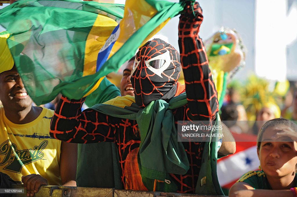 A Brazilian fan fancy dressed as spiderman watches the FIFA World Cup South Africa 2010 football match between Brazil and North Korea on a giant screen in Copacabana beach, in Rio de Janeiro, Brazil on June 15, 2010.