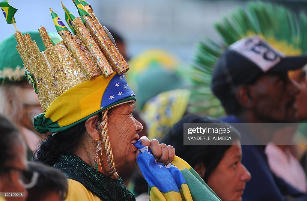 A Brazilian fan gestures at the end of the Brazil vs North Korea match for the FIFA World Cup South Africa 2010, after watching it on a huge screen in Copacabana beach, in Rio de Janeiro, Brazil on 15 June 2010. Brazil won 2-1. AFP PHOTO/Vanderlei ALMEIDA