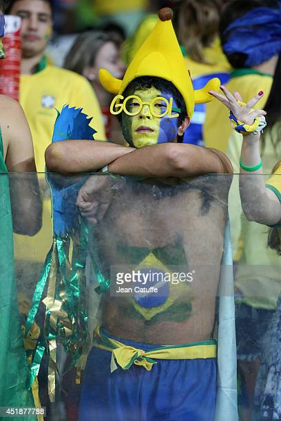 Brazilian fan looks dejected after the 2014 FIFA World Cup Brazil Semi Final match between Brazil and Germany at Estadio Mineirao on July 8, 2014 in...