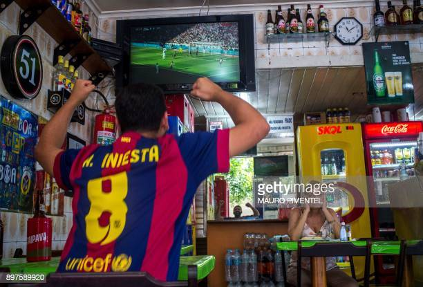 Brazilian fan of Spain's Barcelona celebrates the first goal against Spain's Real Madrid at a bar in Copacabana neighborhood in Rio de Janeiro Brazil...