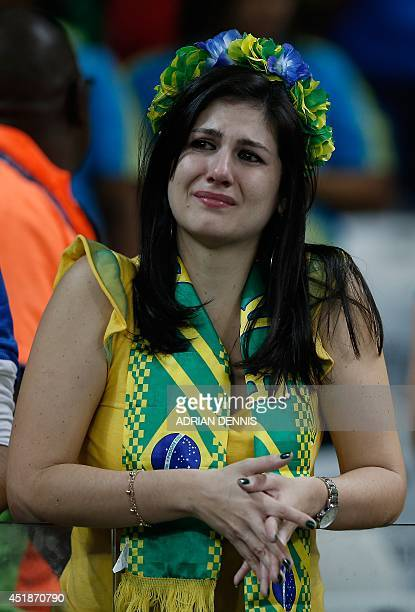 A Brazilian fan reacts at the end of the semifinal football match between Brazil and Germany at The Mineirao Stadium in Belo Horizonte during the...