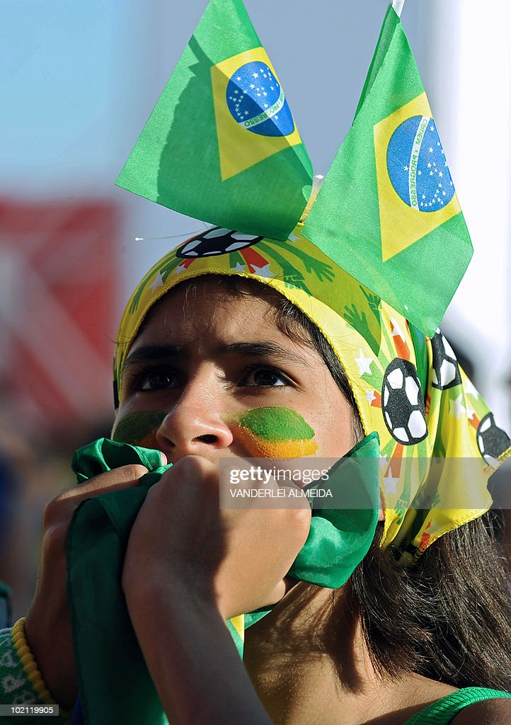 A Brazilian fan reacts in dejection after North Korea's goal to Brazil as she watches the FIFA World Cup South Africa 2010 football match on a giant screen in Copacabana beach, in Rio de Janeiro, Brazil on June 15, 2010.