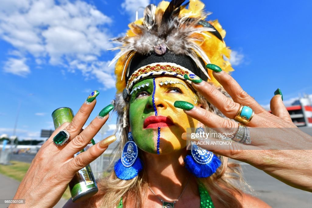 A Brazilian fan with her face and nails painted in the colours of the national flag poses outside the stadium before the Russia 2018 World Cup Group E football match between Serbia and Brazil at the Spartak Stadium in Moscow on June 27, 2018.
