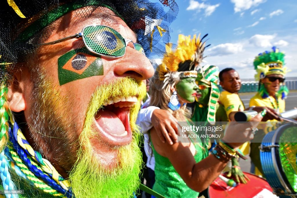 A Brazilian fan with his beard tainted in the colours of the national flag shouts as he poses outside the stadium before the Russia 2018 World Cup Group E football match between Serbia and Brazil at the Spartak Stadium in Moscow on June 27, 2018.