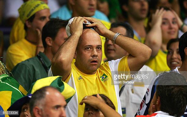Brazilian fans are dejected after Brazil lost to Russia in the women's indoor Volleyball semifinal match on August 26 2004 during the Athens 2004...