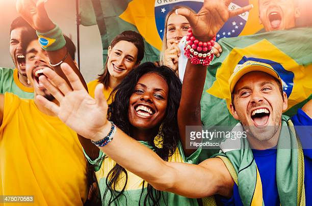brazilian fans at stadium - world cup stock photos and pictures