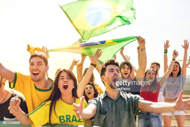 Brazilian fans at stadium supporting their team