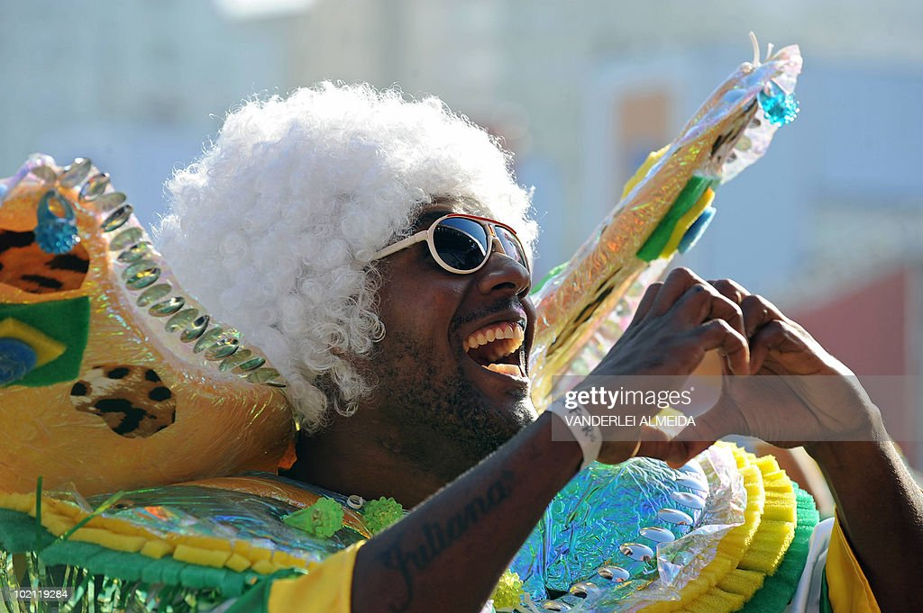 Brazilian fans celebrate their goal against North Korea as they watch the FIFA World Cup South Africa 2010 football match on a huge screen in Copacabana beach, in Rio de Janeiro, Brazil on 15 June 2010.