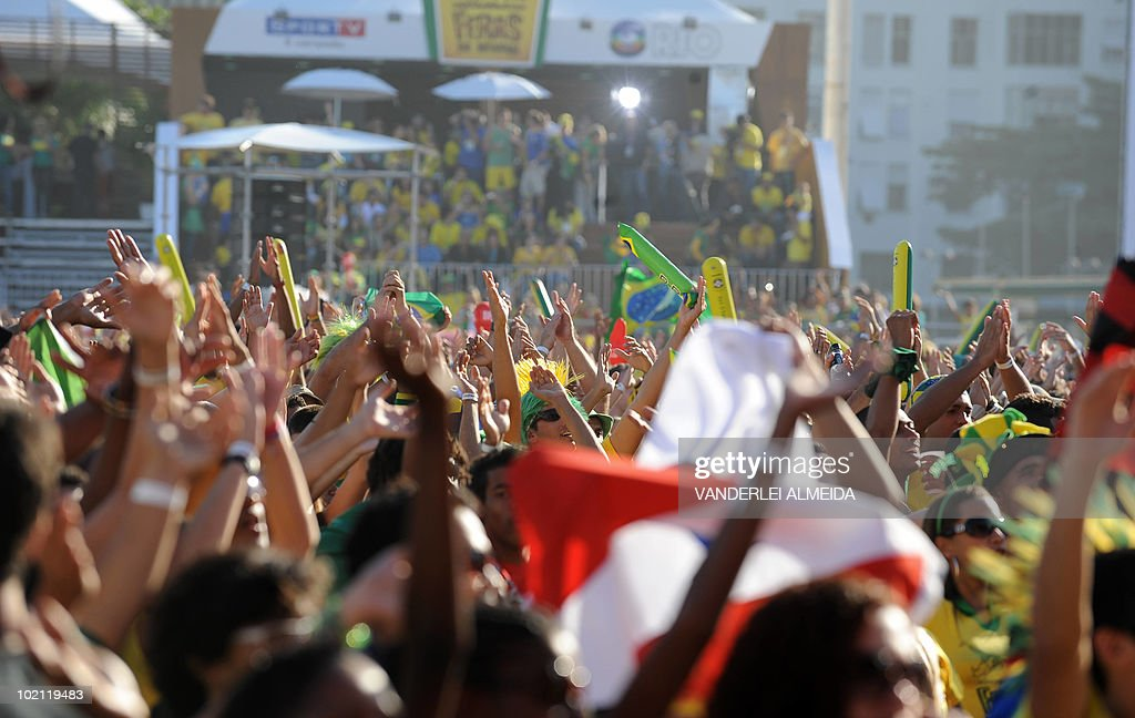 Brazilian fans celebrate their team's goal against North Korea as they watch the FIFA World Cup South Africa 2010 football match on a huge screen in Copacabana beach, in Rio de Janeiro, Brazil on 15 June 2010.