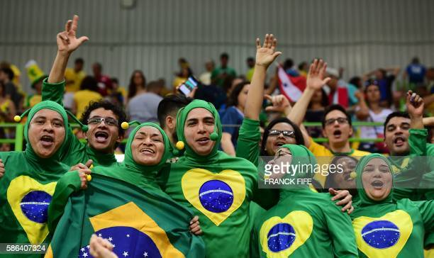 TOPSHOT Brazilian fans cheer during the women's preliminaries Group A handball match Norway vs Brazil for the Rio 2016 Olympics Games at the Future...