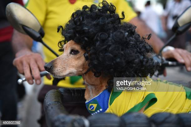 Brazilian fans gather in the surroundings of the FIFA Fan Fest in Copacabana Beach in Rio de Janeiro Brazil on June 12 just minutes before the FIFA...