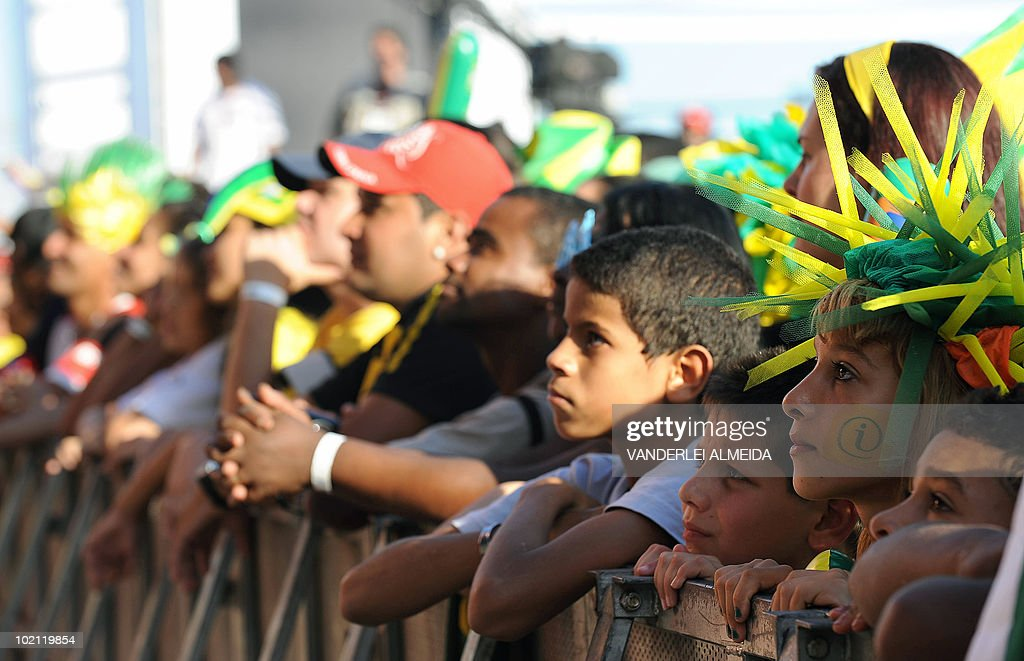 Brazilian fans gesture at the end of the Brazil vs North Korea match for the FIFA World Cup South Africa 2010, after watching it on a huge screen in Copacabana beach, in Rio de Janeiro, Brazil on 15 June 2010. Brazil won 2-1. AFP PHOTO/Vanderlei ALMEIDA