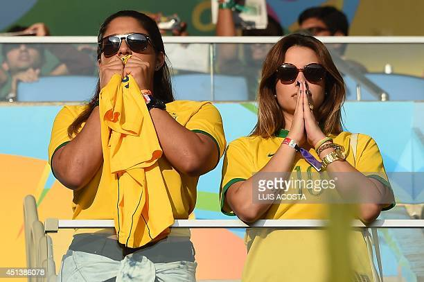 Brazilian fans react as they watch on screen their team playing against Chile prior to the Round of 16 football match between Colombia and Uruguay at...