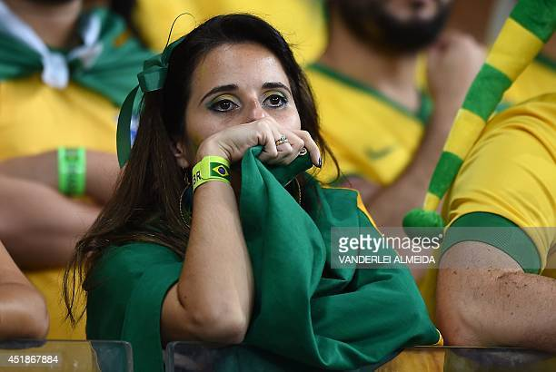 Brazilian fans react during the semifinal football match between Brazil and Germany at The Mineirao Stadium in Belo Horizonte during the 2014 FIFA...