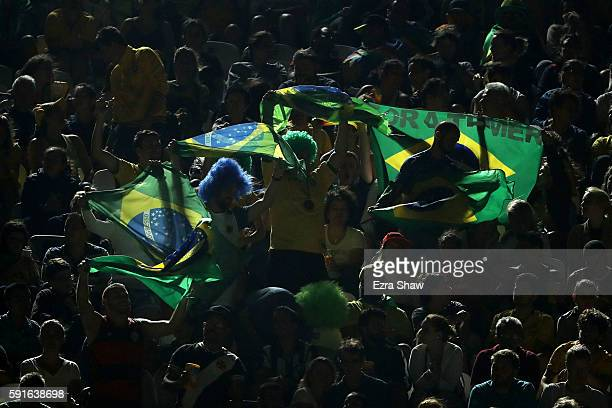 Brazilian fans show their support during the Beach Volleyball Women's Gold medal match Brazil and Germany on day 12 of the Rio 2016 Olympic Games at...
