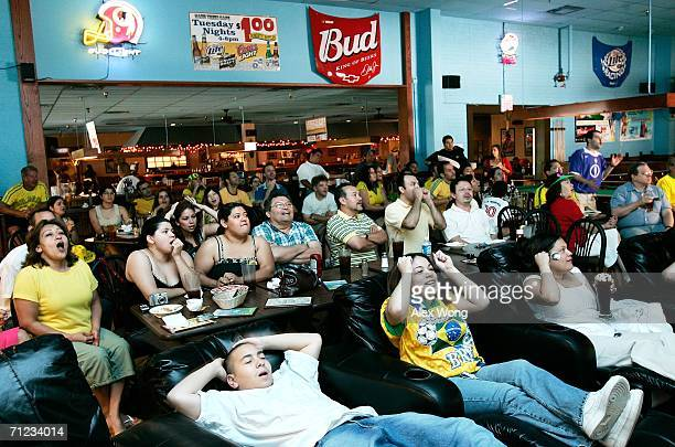 Brazilian fans watch a live broadcast at Hard Times Cafe during the Group F World Cup 2006 match between Brazil and Australia June 18, 2006 in...