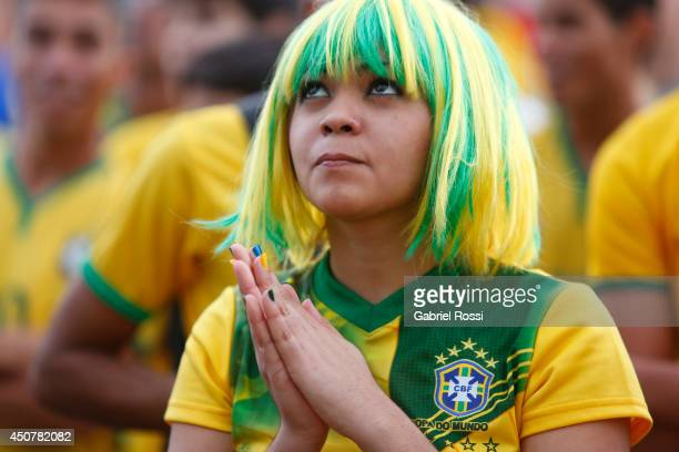 Brazilian fans watch the Group A Match between Brazil and Mexico at the FIFA Fan Fest at Taguatinga on June 17 2014 in Brasilia Brazil