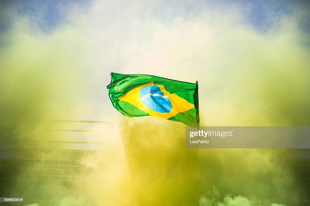Brazilian fans watching and supporting their team at world competition football league : Stock Photo