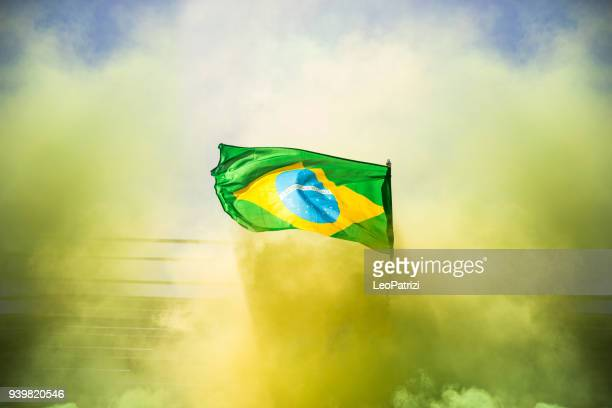 brazilian fans watching and supporting their team at world competition football league - brazil stock pictures, royalty-free photos & images
