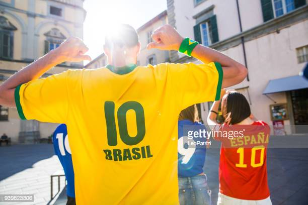 Brazilian fans watching and supporting their team at world competition football league