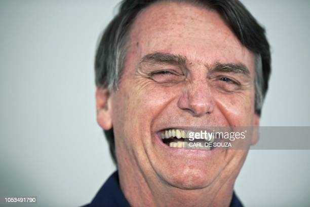 Brazilian farright presidential candidate Jair Bolsonaro gestures as he talks to the press in Rio de Janeiro Brazil on October 25 2018 The...