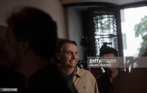 Brazilian farright presidential candidate Jair Bolsonaro visits the Federal Police station in Rio de Janeiro Brazil on October 17 2018 Bolsonaro and...