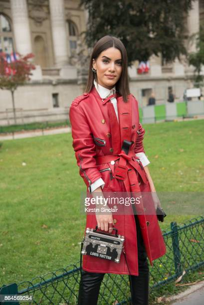 Brazilian fashion blogger Camila Coelho wears all Louis Vuitton day 2 of Paris Womens Fashion Week Spring/Summer 2018 on September 27 2017 in London...