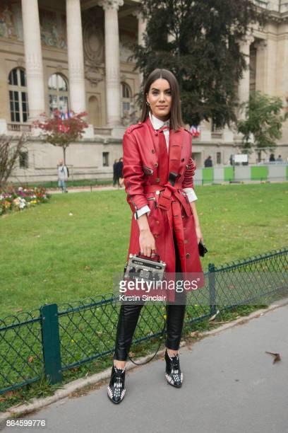 Brazilian fashion blogger Camila Coelho wears all Louis Vuitton day 2 of Paris Womens Fashion Week Spring/Summer 2018 on September 27 2017 in London...