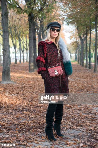 Brazilian fashion blogger Camilla Carril wears an Ekaterina Kukhareva dress Dior bag Jimmy Choo boots Marc Jacobs sunglasses Isabel Marant hat and...