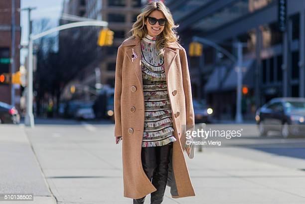 Brazilian fashion blogger Helena Bordon wearing a Zimmermann dress a white Jimmy Choo clutch a beige Animale Brasil wool coat black Gianvito Rossi...