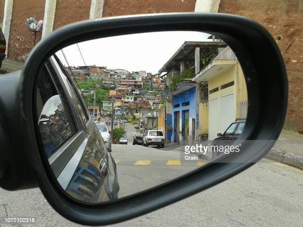brazilian favela in the car rearview mirror - favela imagens e fotografias de stock