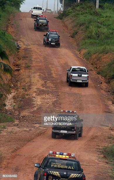 Brazilian federal police cars go along a road in the outskirts of Tailandia Para northen Brazil on February 27 2008 The Brazilian government launched...
