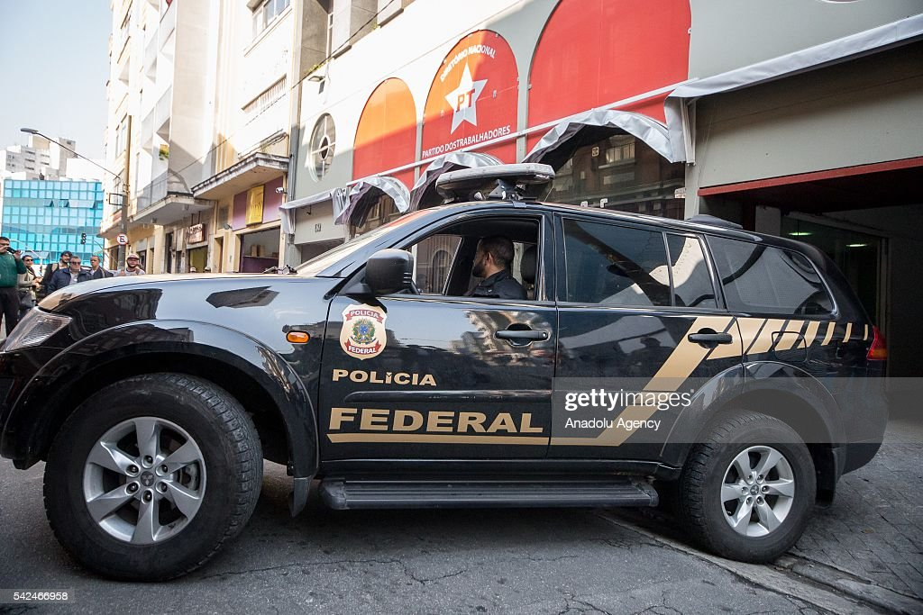 Brazilian Federal Police with search and seizure warrant