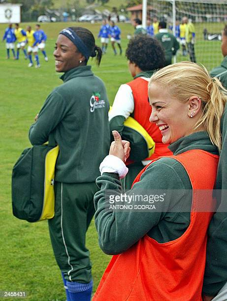 Brazilian female soccer player Milene Domingues, wife of Ronaldo Nazario soccer star, gives a thumb up during the male national soccer team training...