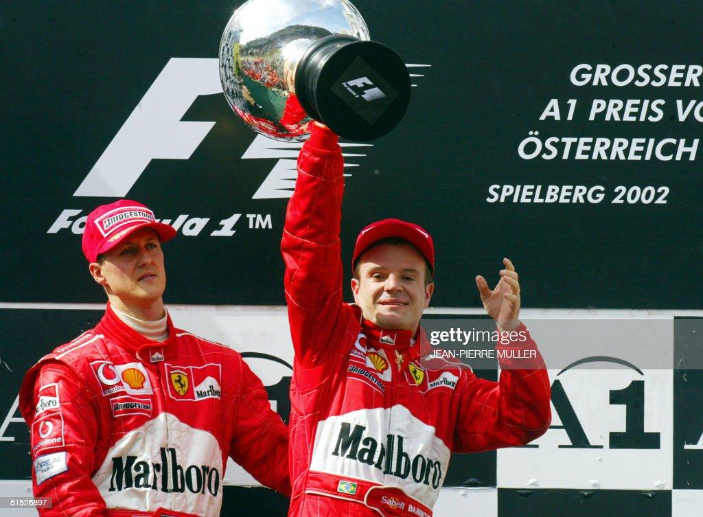 Brazilian Ferrari driver Rubens Barrichello holds : News Photo