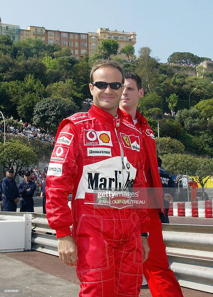 Brazilian Ferrari driver Rubens Barrichello smiles as he arrives in the pits of the Monte-Carlo racetrack during the first free practice session three days before the Monaco Grand Prix, 20 May 2004 in Monaco.