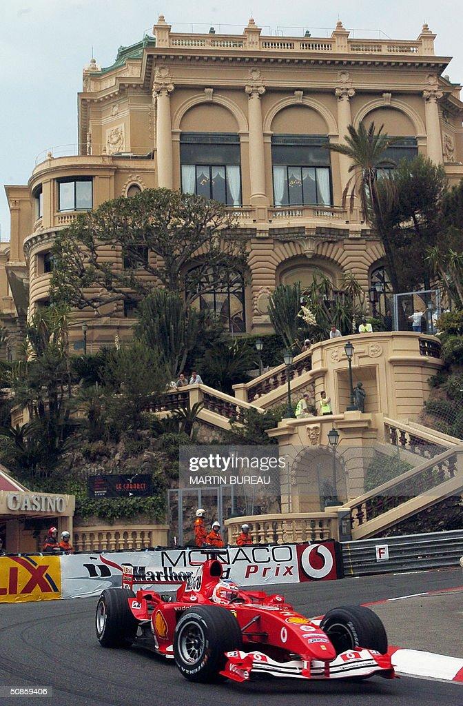 Brazilian Ferrari driver Rubens Barrichello steers his car on the Monte-Carlo racetrack during the second free practice session three days before the Monaco Grand Prix, 20 May 2004 in Monaco.