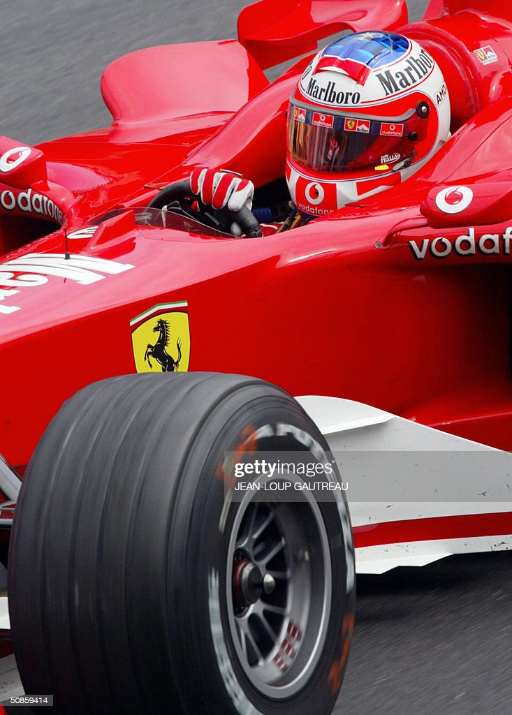 Brazilian Ferrari driver Rubens Barrichello steers his car on the Monte-Carlo racetrack during the second free practice session three days before the Monaco Grand Prix, 20 May 2004 in Monaco.