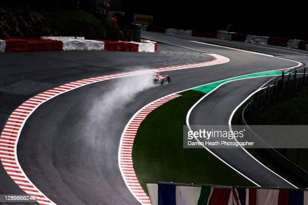 Brazilian Ferrari Formula One racing driver Felipe Massa driving his Ferrari F10 racing car in wet rain conditions through the Raidillon Corner...