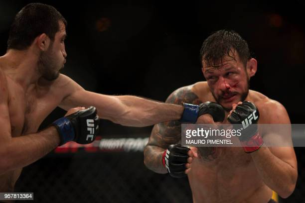 Brazilian fighter Alberto Mina competes against Russian fighter Ramazan Emeev during their welterweight bout at the Ultimate Fighting Championship...