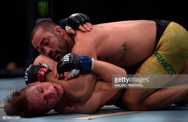 Brazilian fighter Davi Ramos competes against German fighter Nick Hein during their lightweight bout at the Ultimate Fighting Championship 224 event...