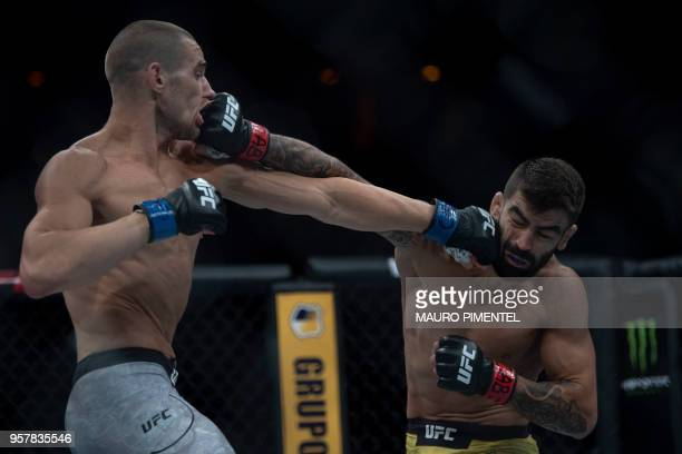 """Brazilian fighter Elizeu Zaleski dos Santos """"Capoeira"""" competes against US fighter Sean Strickland during their welterweight bout at the Ultimate..."""