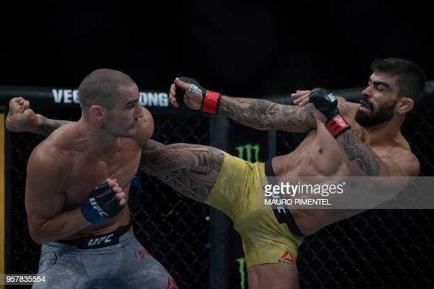 Brazilian fighter Elizeu Zaleski dos Santos Capoeira competes against US fighter Sean Strickland during their welterweight bout at the Ultimate...