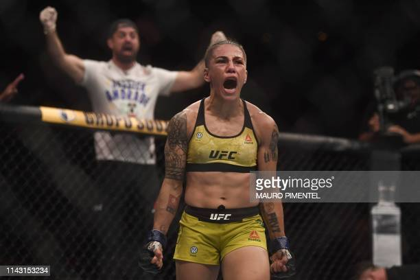 Brazilian fighter Jessica Andrade celebrates her victory against US fighter Rose Namajunas during their women's strawweight title bout at the...