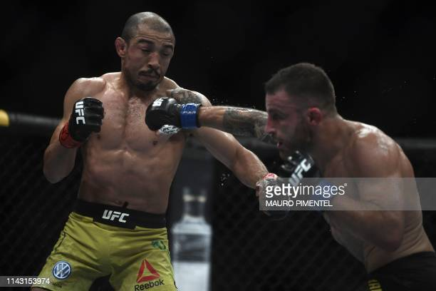 Brazilian fighter Jose Aldo competes against Australian fighter Alexander Volkanovski during their men's featerweight bout at the Ultimate Fighting...