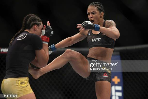 Brazilian fighter Talita Bernardo competes against Brazilian fighter Viviane Araujo during their women's bantamweight bout at the Ultimate Fighting...